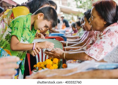 PHATTHALUNG, THAILAND - APRIL 13: Unidentified Thai people celebrate Songkran festival by giving garlands to their seniors and asked for blessings on April 13, 2014 in PHATTHALUNG, Thailand.