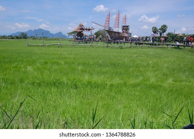 Phatthalung , THAILAND - APRIL 7 2019 : Tourists are visiting rice fields nature and King Kong, Bark building at Sampaothai resort. During the holidays in summer , Phatthalung Province, Thailand.