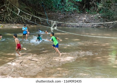 PHATTHALUNG, THAILAND - April 8, 2018 : Childern are play in the water at Klong Ban Kham in the forest at Srinagarindra District, Phatthalung.