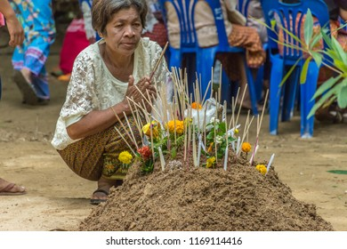 PHATTHALUNG, THAILAND - April 8, 2018 : People make merit for cerebrate Songkran festival at Klong Ban Kham in the forest at Srinagarindra District, Phatthalung.