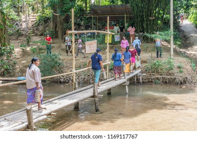 PHATTHALUNG, THAILAND - April 8, 2018 : People walking on the wood bridge cross Klong Ban Kham, canal in the forest at Srinagarindra District, Phatthalung.