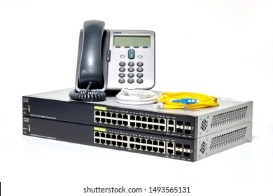 Phatthalung , THAILAND - AUGUST 3 2019 : Cisco 7912 IP Telephone and Cisco SG350-28P , Network ethernet switch 28 port gigabit PoE management switch and fiber optic cable. isolated on white background