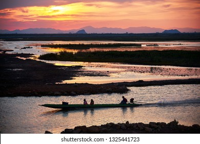Phatthalung, Thailand- February 11, 2019- Tourists on the longtail boat and scene of sunset and beautiful sky at Tale Noi, Phatthalung from the longest bridge in Thailand