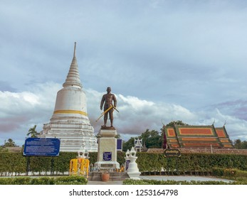 PHATTHALUNG, THAILAND - July 28, 2018: The pagoda and a statue at Wat Wang temple in Lam Pam, Muang Phatthalung District, Phatthalung Province