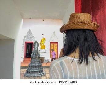 PHATTHALUNG, THAILAND - July 28, 2018:Tourists take photo the door facade ,Wat Wang,Phatthalung,Thailand