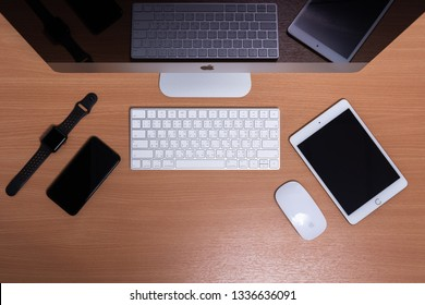 PHATTHALUNG, THAILAND - March 1, 2019 : Top view of iMac Computer, iPad, iPhone and Apple watch on wooden table