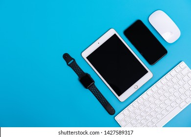 PHATTHALUNG, THAILAND - March 1, 2019 : Top view of Apple watch, iPad, iPhone X, magic mouse and keybard