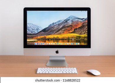 PHATTHALUNG, THAILAND - MARCH 24, 2018: iMac computer, keyboard, magic mouse on wooden table, created by Apple Inc.