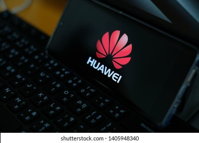 Phatthalung , THAILAND - MAY 24 2019 : Close up HUAWEI Logo on Huawei P30 Pro screen , Huawei mobile on black keyboard and Huawei P30 Pro text background