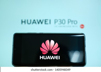 Phatthalung , THAILAND - MAY 24 2019 : Close up HUAWEI Logo on Huawei P30 Pro screen , Huawei mobile and Huawei P30 Pro text background