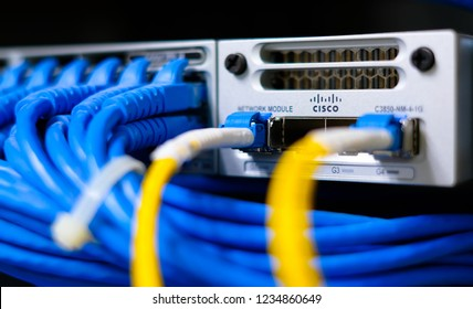 Phatthalung , THAILAND - NOV 1 2018 : Close up Cisco C3850-NM-4-1G , Router Switch layer 3 with fiber optic cable and UTP cat6 network cable