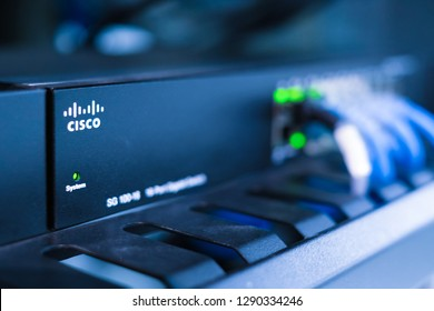 Phatthalung , THAILAND - NOV 1 2018 : Close up Cisco SG 100-16  , Gigabit Switch for small business with UTP cat6 network cable