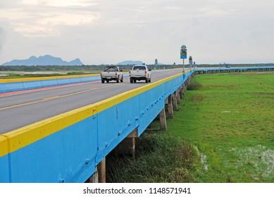 Phatthalung Thailand - November 5 2016 : Landmark Longest Sea Bridge in Thailand is call Chaloem Phrakiat 80 Phansa Bridge Colorful Road bridge cross the lake at Thalay Noi Lake Phatthalung Thailand