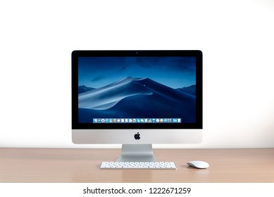 PHATTHALUNG, THAILAND - September 28, 2018: iMac computer, keyboard, magic mouse on wooden table, created by Apple Inc.