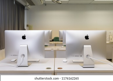 PHATTHALUNG, THAILAND - September 6, 2018: Backside of  iMac computers lab on table in classroom, created by Apple Inc.
