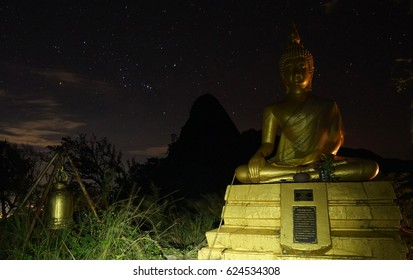 PHAYAO, THAILAND - 26 NOVEMBER 2016: Statue of Buddha and bell on mountain forest with sky of full stars  at Doi Nork Doi Luang National Park