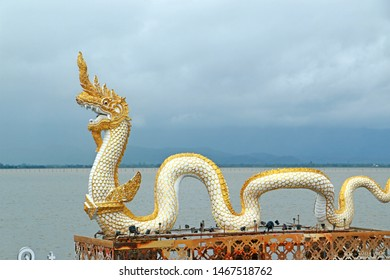 Phayao,Thailand,11 June 2018; morning of Twin white Nagas with golden pagoda is the most popular landmark at kwan phayao or phayao lake in phayao province thailand.