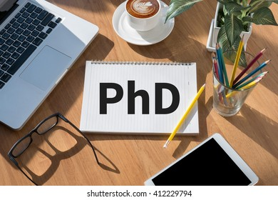 PhD Doctor of Philosophy Degree Education Graduation open book on table and coffee Business