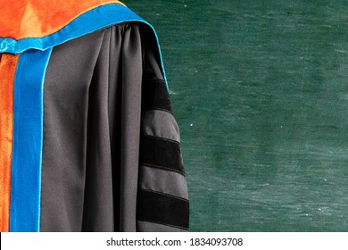 PhD graduate in black gown University degree