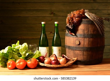 Pheasant, wine bottle and vegetables on the table