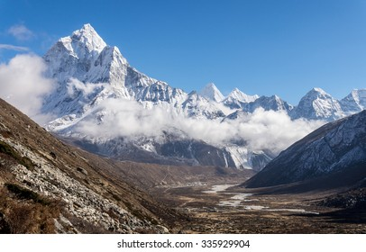 Pheriche valley on the way to Everest Base Camp with snowy mountains in the background. Mount Ama Dablam is on the left.