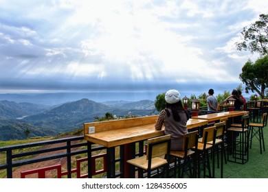 Phetchabun, Thailand - January 05, 2019: landscape of green mountain and cloudy sky at Takmoh Coffee Shop, Khao Kho, Phetchabun, Thailand