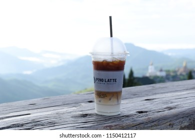 Phetchabun, Thailand - July 7, 2018: Coffee in white cup with nature view behind in Khao Kho,Pino Latte coffee shop, Phetchabun, Thailand.