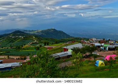 Phetchabun, Thailand - June 9, 2019: Morning view point with Cabbage vegetable garden and mountain mist in Phu Thap Boek most famous travel place in Thailand