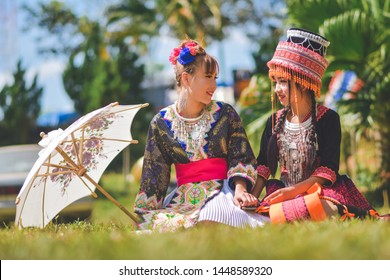Phetchabun, Thailand, Dec 19, 2015 - Portrait of couple teen Hmong girls in beautiful traditional Hmong costumes on Hmong new year festival