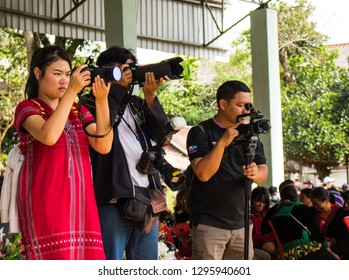 Phetchabun, Thailand – December 10, 2018 Countryside festival in Hmong village, the photographers are taking pictures with digital camera and smartphone