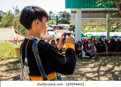 Phetchabun, Thailand – December 14, 2018 Countryside festival in Hmong village, tourist taking pictures with smartphone