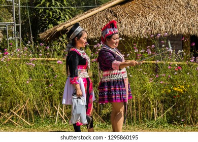 Phetchabun, Thailand – December 16, 2018 Girls taking smart phone self-portrait pictures with selfie stick. Asian girls having fun doing mobile photography with smartphone for social media