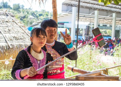 Phetchabun, Thailand – December 16, 2018 Girlfriend taking smart phone self-portrait pictures with boyfriend selfie stick.
