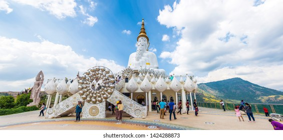 PHETCHABUN, THAILAND - January 13, 2019: Tourist come to visit the beautiful of big five white buddha statue in Wat Phra That Pha Sorn Kaew with beautiful sky background, Phetchabun, Thailand.