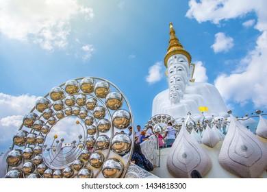 PHETCHABUN, THAILAND - January 13, 2019: Big five white buddha statue in Wat Phra That Pha Sorn Kaew with beautiful sky background, Phetchabun, Thailand.