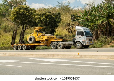 Phetchabun, THAILAND – January 31, 2018 Lowboy semi-trailer carrying vibratory soil compactor on the Asian highway