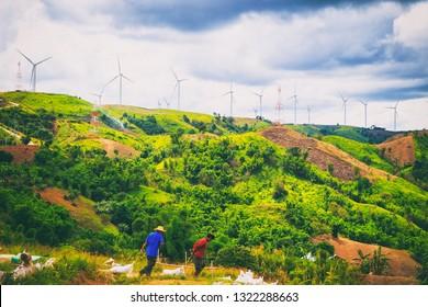 PHETCHABUN, THAILAND - JUNE 24, 2017 : People work at construction site of Wind power farm at Phetchabun, Thailand.