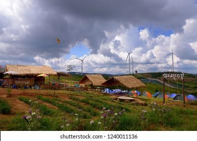Phetchabun, Thailand - November 16, 2018 : Viewpoint of many wind turbine and sky with white cloud at Windtime Khaokho, Phetchabun, Thailand.
