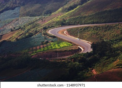 PHETCHABUN, THAILAND - NOVEMBER 28, 2010: Car on Curved winding road on the mountain and trough the forest aerial view in Thailand