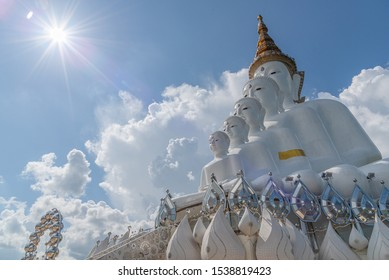 Phetchabun, Thailand-14 October 2019 : Five white Buddha statue sequences on the state among cloudy and blue sky at Wat Pha Sorn Kaew (Temple on the Glass Cliff)