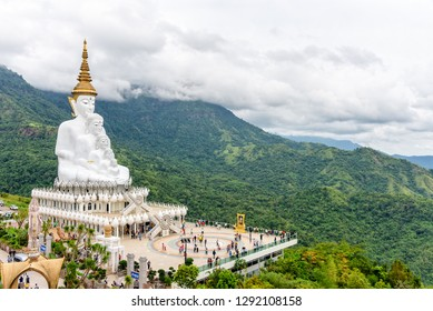PHETCHABUN, THAILAND-OCT 24,2018: Many tourists on the terrace viewpoint under the large white Buddha statue on mountain at Wat Phra That Pha Sorn Kaew Temple in Khao Kho, Phetchabun, Thailand