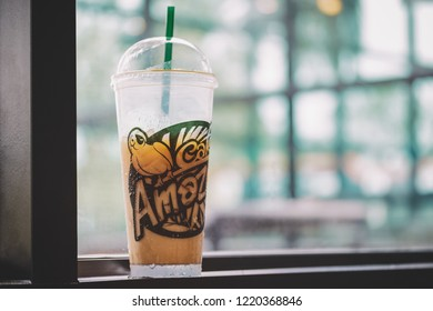 Phetchabun,Thailand-July 21,2018: Coffee cup have a word with Cafe Amazon on window in cafe vintage style and copy space used for add messages at Cafe Amazon beverage shop at PTT oil station.