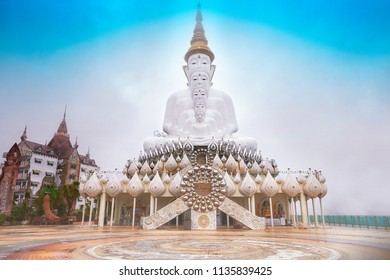 Phetchabun,Thailand-June 27, 2018: White big buddha,Wat Prathat Phasornkaew with 5 Buddha's Basilica in the morning mist.