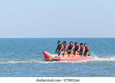 PHETCHABURI THAILAND 4 FEBRUARY : Unidentified tourist are excited on banana boat at cha-am beach on 4 February, 2017 at Phetchaburi, Thailand