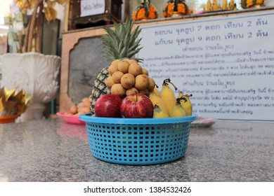 PHETCHABURI, THAILAND - APRIL 16, 2019 - The image of peoples brings a fruit basket for redeem a vow to a god at Wat Mahathat Woravihara temple in Buddhist holy day in Phetchaburi.