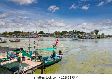 Phetchaburi, Thailand, August 25th 2017 : The Fisherman Village along the shore of the Gulf of Thailand under the clear blue sky, show the way of life of the fisherman and their fish boats.