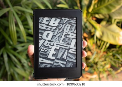 Phetchaburi, Thailand - August 3 2020: Amazon Kindle Paper White, e-book reader on hand among nature