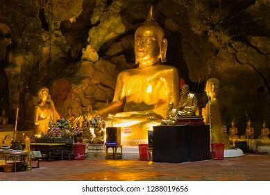 PHETCHABURI, THAILAND - DECEMBER 13, 2018: Sculpture of a sitting Buddha close-up. Cave Temple Wat Tham Khao Luang