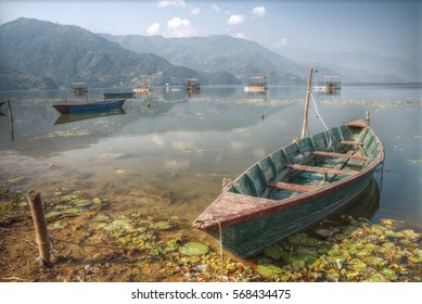 Phewa Lake - the second largest lake in Nepal located in the Pokhara Valley near the town and the mountain Sarangkot.
