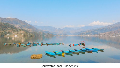 phewa lake view with lots of boat floating on water